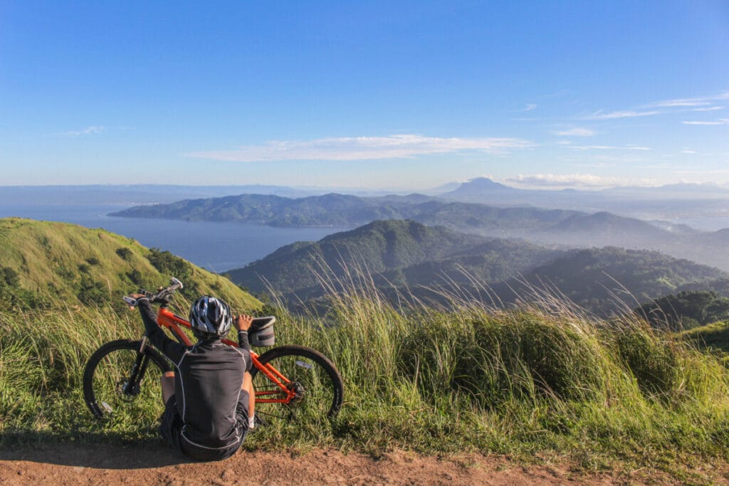 man and ebike on mountain track